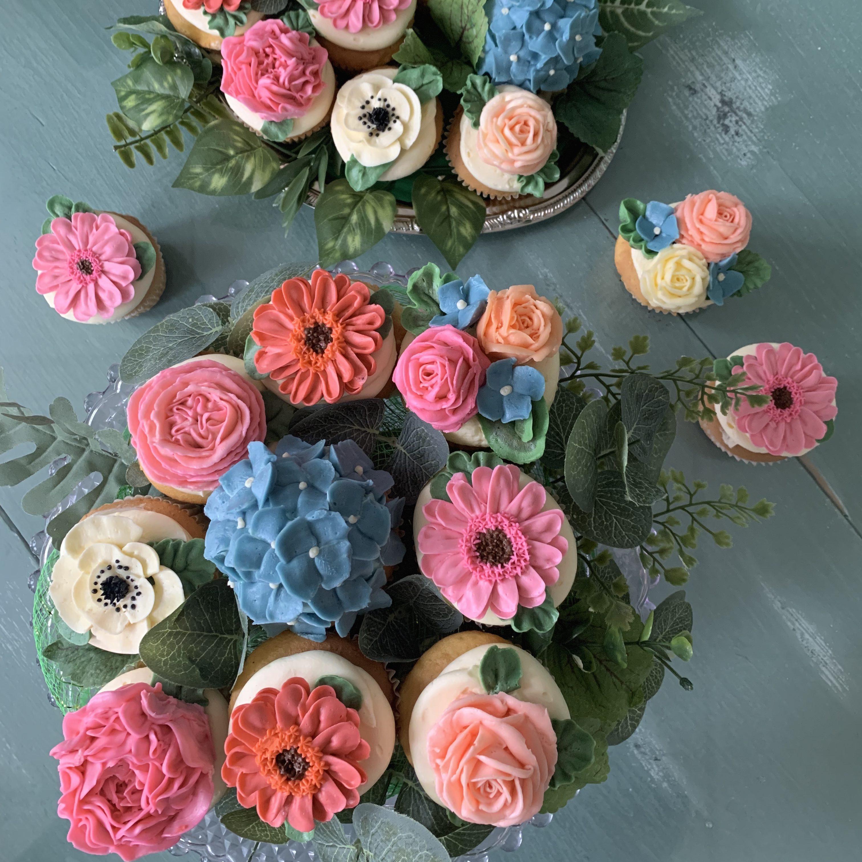 https://delicatelydelicious.com/wp-content/uploads/2019/05/Mutlicolored-Floral-Cupcakes-e1558371092581.jpg